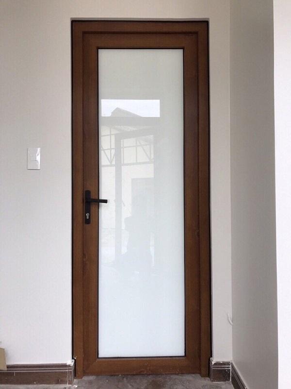 Mẫu cửa nhôm kính giả gỗ đơn giản cho phòng ngủ