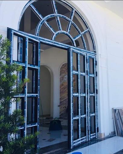 Mẫu cửa nhôm xingfa uốn vòm chia ô hiện đại