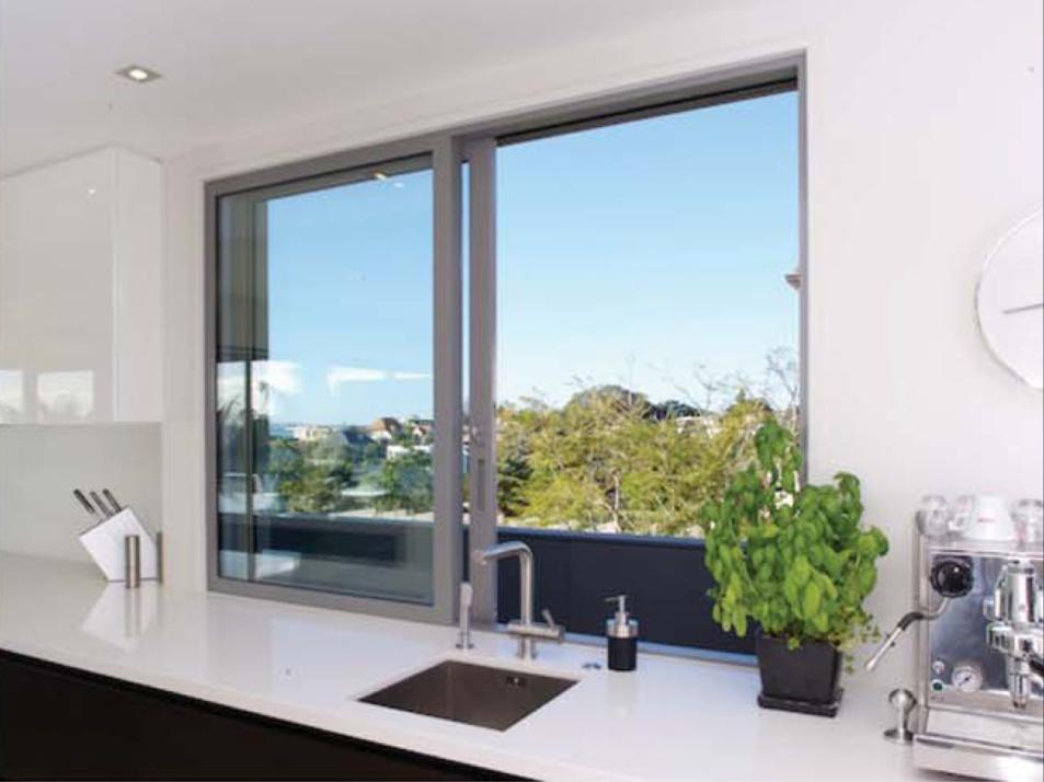 Mẫu cửa sổ nhôm kính phòng bếp mở lùa màu xám ghi